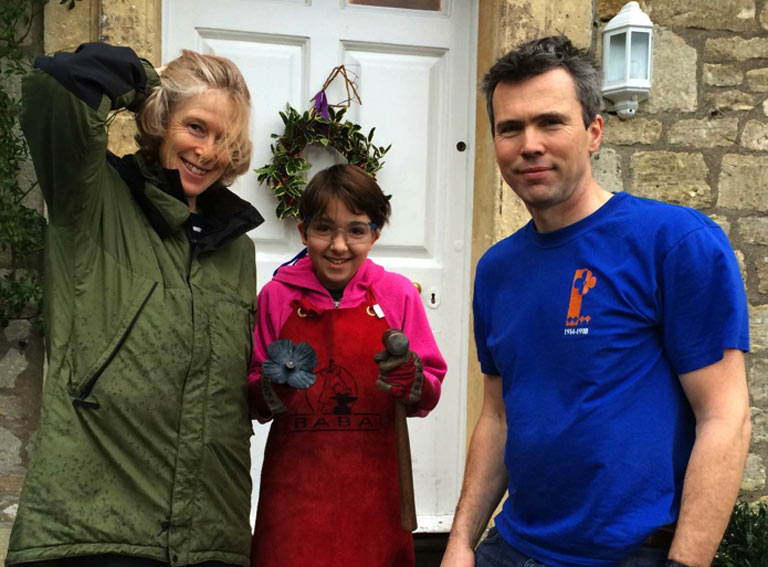 Rachel and Edward Leigh-Wood of Swainswick Explorers with a proud and happy poppy maker.