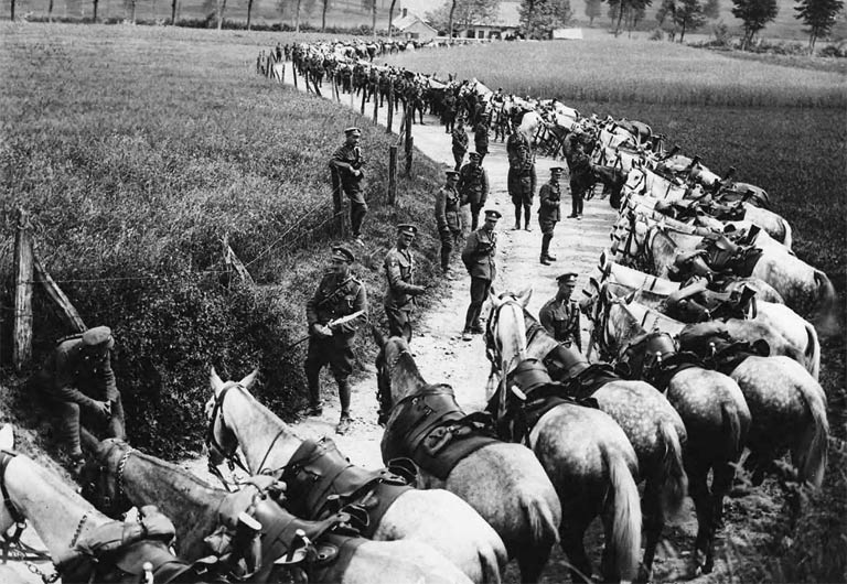 Members of the Royal Scots Greys Cavalry Regiment rest their horses by the side of the road, in France. (National Library of Scotland)